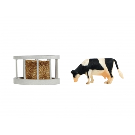 Feeder ring with round bale and cow