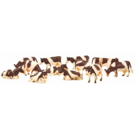 12 cow figurines Brown/White Laying
